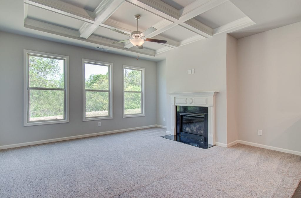 living room with coffered ceilings