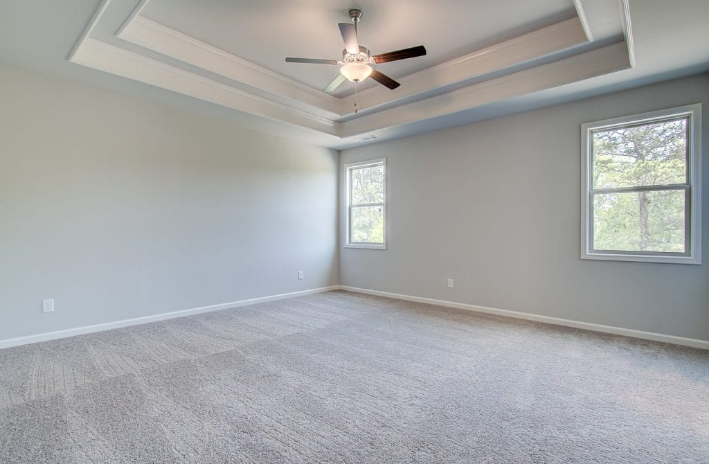 primary bedroom with carpet
