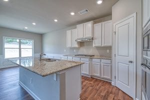 New Home Plan by Chafin Communities The Denton with White Cabinets in Upgrade Gourmet Kitchen
