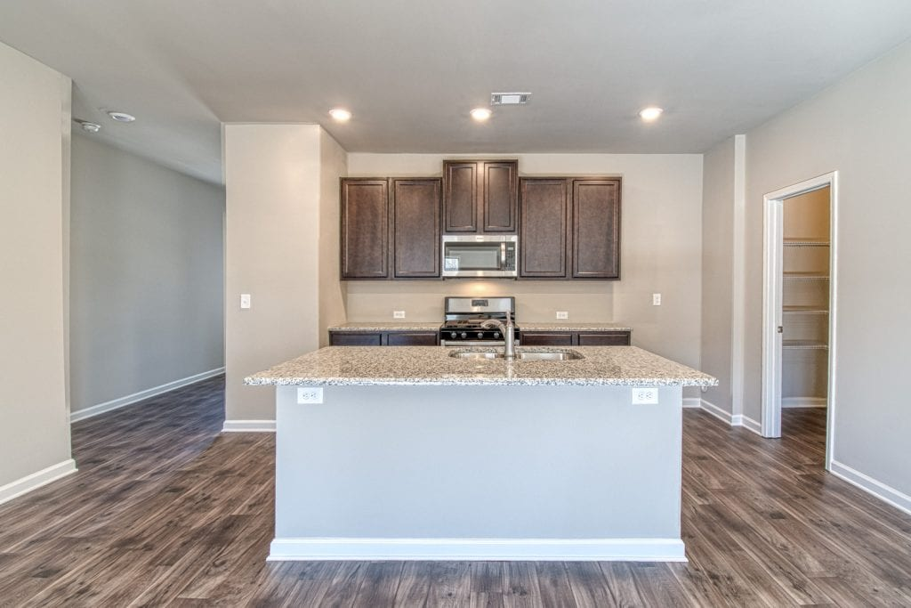New Home Plan by Chafin Communities The Joshua with Brown Cabinets in Kitchen