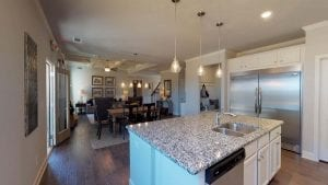 Brunswick-I-by-Chafin-Communities_Model-at-Mundy-Mill-Kitchen-to-Great-Room