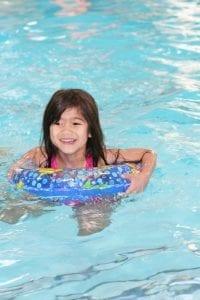 Kid swimming in pool