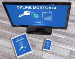 Online mortgage concept shown on different information technology devices