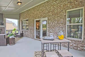 45-Turnbridge-Model-at-Village-at-Ivy-Springs-By-Chafin-Commiunities-Covered-Rear-Porch-Screened-In.