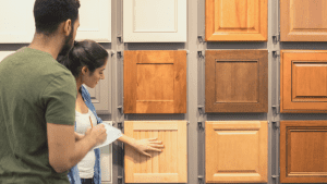 man and woman shopping for wood cabinets